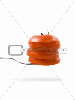 tomato slices on the fork