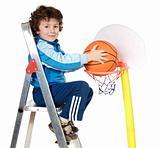 adorable child playing the basketball