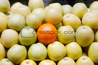 accumulated apples whit a orange