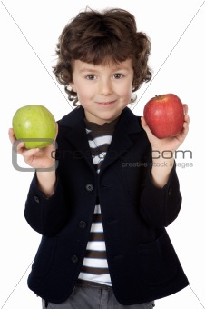 Adorable child with two apples in the hands
