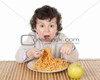 Adorable child hungry at the time of eating