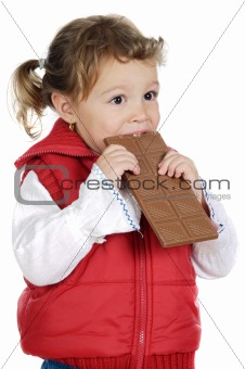 adorable girl eating chocolate