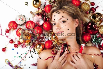 Beautiful model with Christmas decorations on white