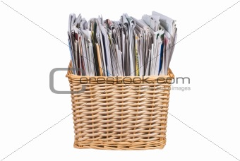 Wicker basket with newspapers and catalogs