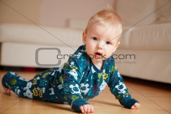 6 mobth old baby crawling on floor at home