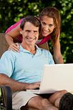 Happy Middle Aged Man and Woman Couple Using Laptop Computer