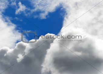Blue sky through white clouds