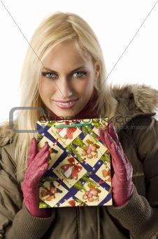 blond girl christmas with christmas bag