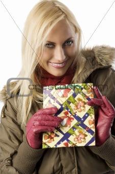 blond girl with christmas bag