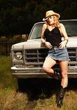 Cowgirl in Front of Truck