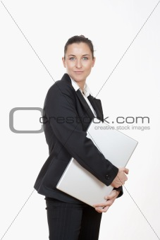 attractive young businesswoman with laptop computer smiling