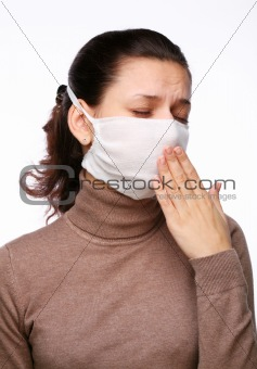 Coughing woman in a medical mask on a white background