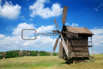 Old windmills in the  summer countryside