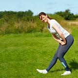 Young woman doing exercise outdoors
