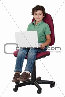 Adorable little boy sitting on big chair with laptop