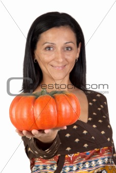 Attractive girl with a big pumpkin