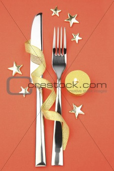 knife and fork with ribbon, stars and candle