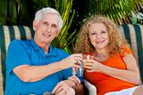 Senior Man and Woman Couple Enjoying Retirement Drinks on Vacati
