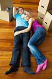 Couple lying on the floor. Moving house
