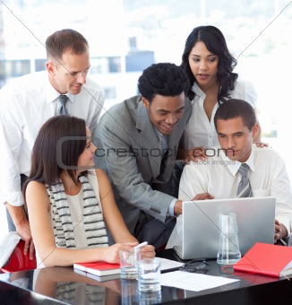 Business people working together with a laptop