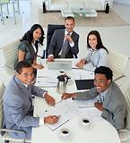 Smiling business people working in a meeting