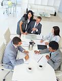 Multi-ethnic businessteam working in a project in a meeting
