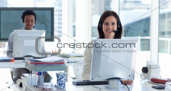 Beautiful brunette businesswoman working in a call center