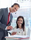 Manager working with businesswoman in a call center