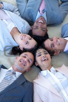 Business team on floor in a circle