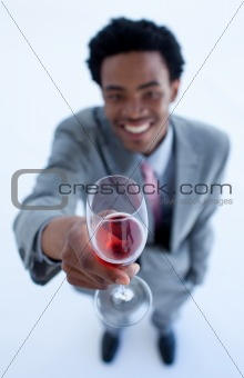 Afro-American businessman celebrating a success with wine