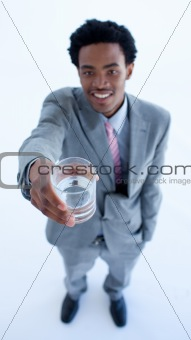Afro-American businessman holding a glass of water