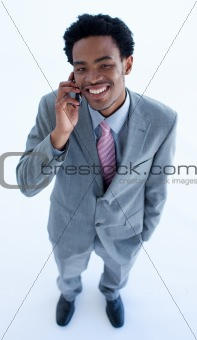 Smiling businessman speaking on a mobile phone