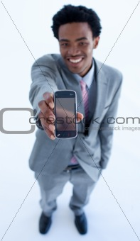 Afro-American businessman showing a mobile phone to the camera