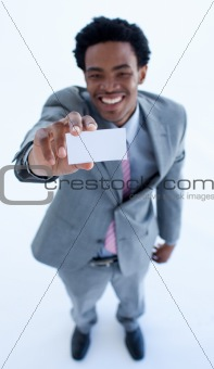 Smiling Afro-American businessman holding a business card
