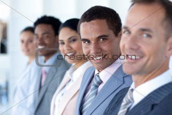 Attractive businessman in a row with his team