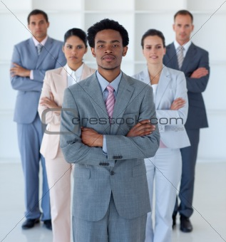 Afro-American businessman in front of his team