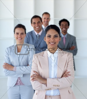 Business team standing in office looking at the camera