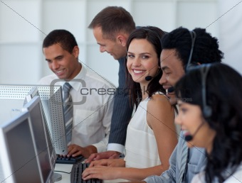 Business team working in a call center with a manager