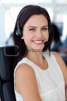 Portrait of attractive businesswoman in a call centre