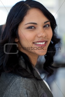 Portrait of friendly businesswoman in office smiling at the came