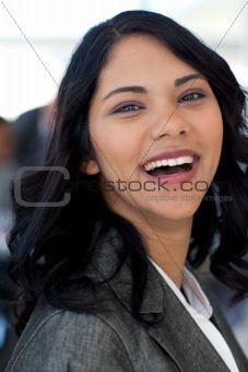Portrait of smiling ethnic businesswoman in office