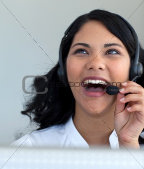 Beautiful businesswoman talking in a call center