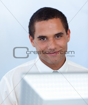 Attractive businessman working with a computer