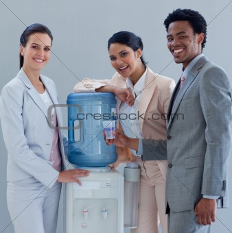 Business colleagues talking around a water cooler