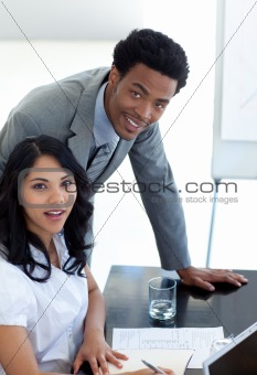 Afro-American businessman working with his colleague