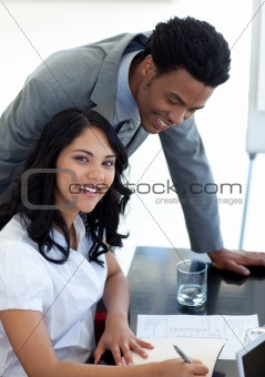 Afro-American businessman talking to his colleague