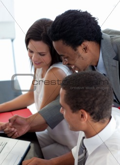 Afro-American businessman working with his colleagues