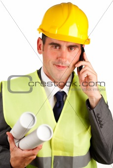 Architect man holding plans talking on phone