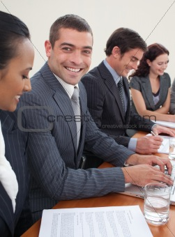 Smiling attractive businessman in a meeting