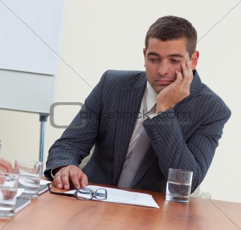 Attractive businessman bored in a meeting